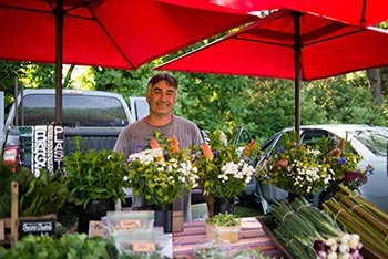 A flower vendor is pictured from the Farmers Market at the Walker Tavern.