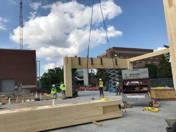 Workers assemble a mass timber building at Michigan State University.