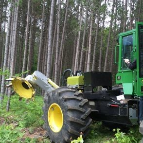 A skidder heads into the woods to do some forest work.