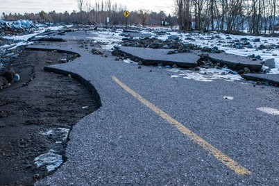 Cracked pavement is shown along Lakeshore Boulevard in Marquette, caused by high-water storms off Lake Superior.