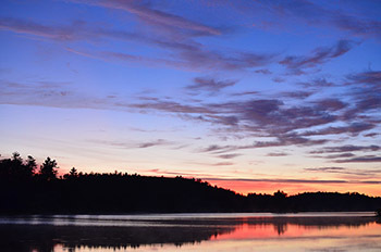 Sunrise is shown over Deer Lake in Marquette County one of Michigan's recovered Areas of Concern.
