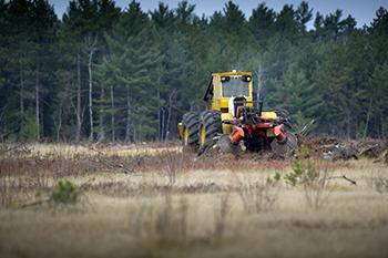 trencher prepares soil for planting
