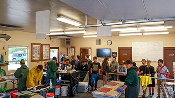 Students are shown visiting the Lower Manistee River facility.