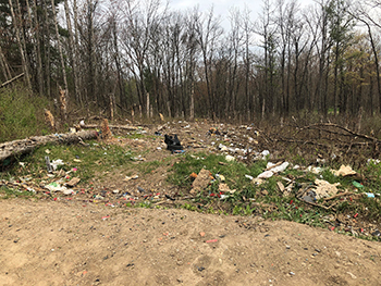 Rogue River State Game Area with trash strewn around