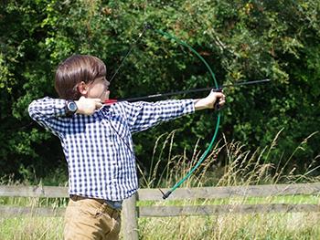Boy shooting boy and arrow