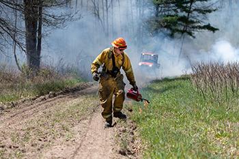 DNR employee working on prescribed burn