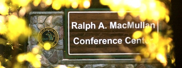 RAM center sign framed with yellow leaves