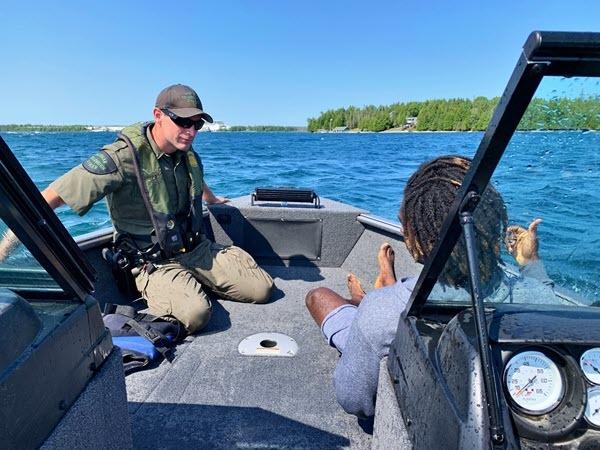 conservation officer on boat