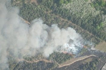 an aerial view of billowing smoke obscuring the roads and landscape during the Colfax Fire in Wexford County