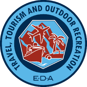 Economic development administration logo: A blue circle with dark blue writing and the images of a plane, ship and palm tree in red.