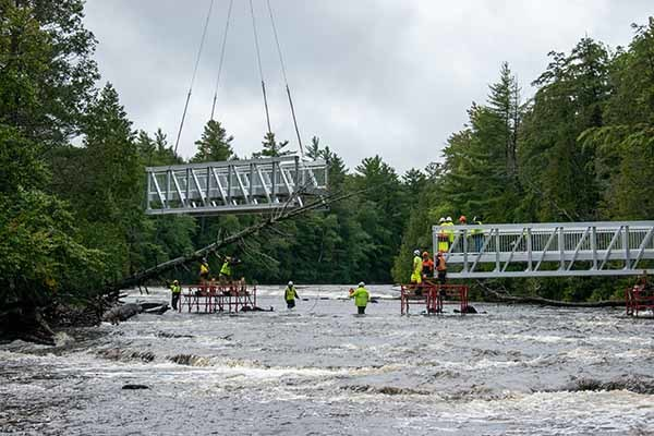 The third segment of the bridge is dropped into place at the Lower Tahquamenon Falls today.
