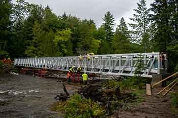 Workmen on the bridge with all four segments in place.