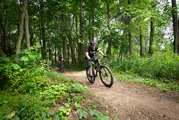 mountain bikers on DTE Trail