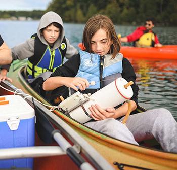 Volunteers in kayaks
