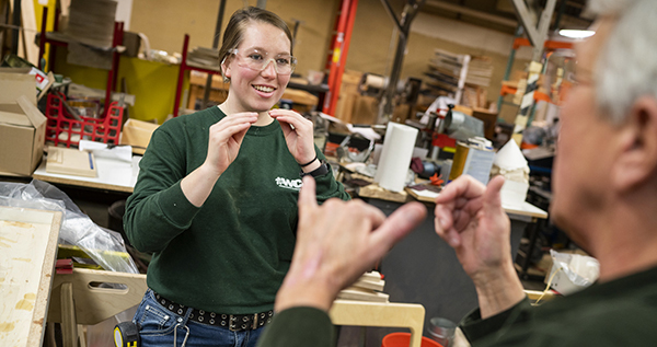 Photo of worker using sign language