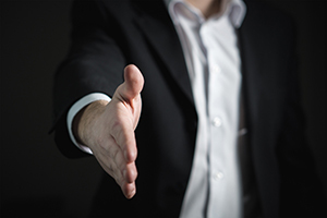 photo of person extending hand