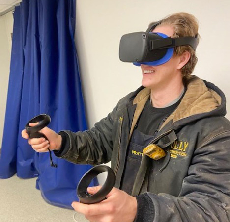 Holly Construction employee using virtual reality goggles for training program