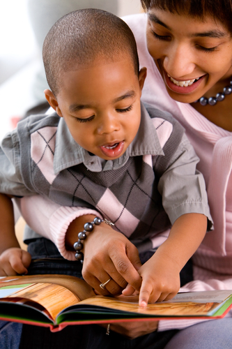 Young Boy reading with mother