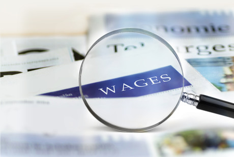 Wages with inspection magnifying glass