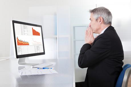 Worker using computer data