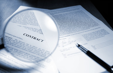 Contract and magnifying glass