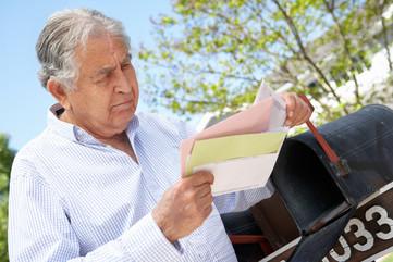 Man scanning his delivered mail