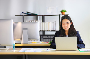 Woman setting at desk with laptop