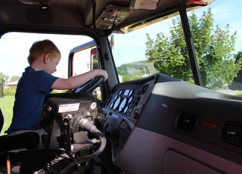 Kid in plow truck