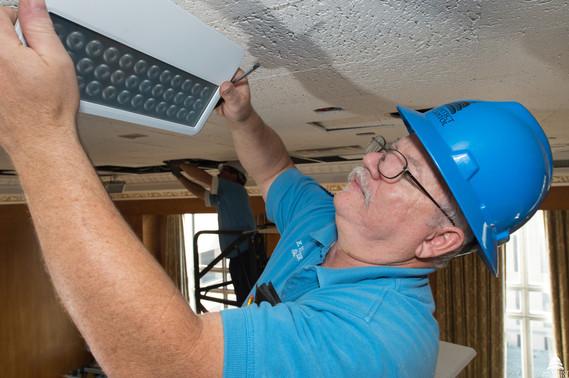 Man installing energy-efficient lighting