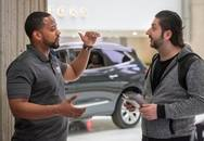 Two men talking at a career fair.