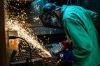 Welder welding a piece of metal.