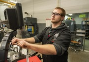 A student using a CNC machine in their early college pre-apprenticeship program.