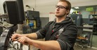 Allegan County machining student using a CNC machine.