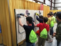 A group of students learning how to wiring works at MiCareerQuest Northeast.