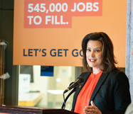 Gov. Gretchen Whitmer talking at the podium at a Going PRO in Michigan press conference.
