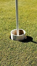 A PVC pipe inside the golf hole provides a no touch cup option for golfers.