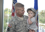 Army officer holding child