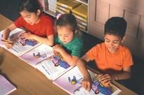 Three kids reading their books