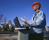 Construction manager with laptop