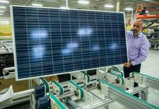 Man with a solar panel