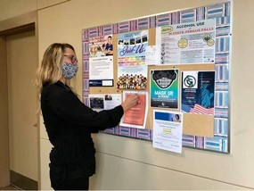 RMCEP staff person putting up flyer