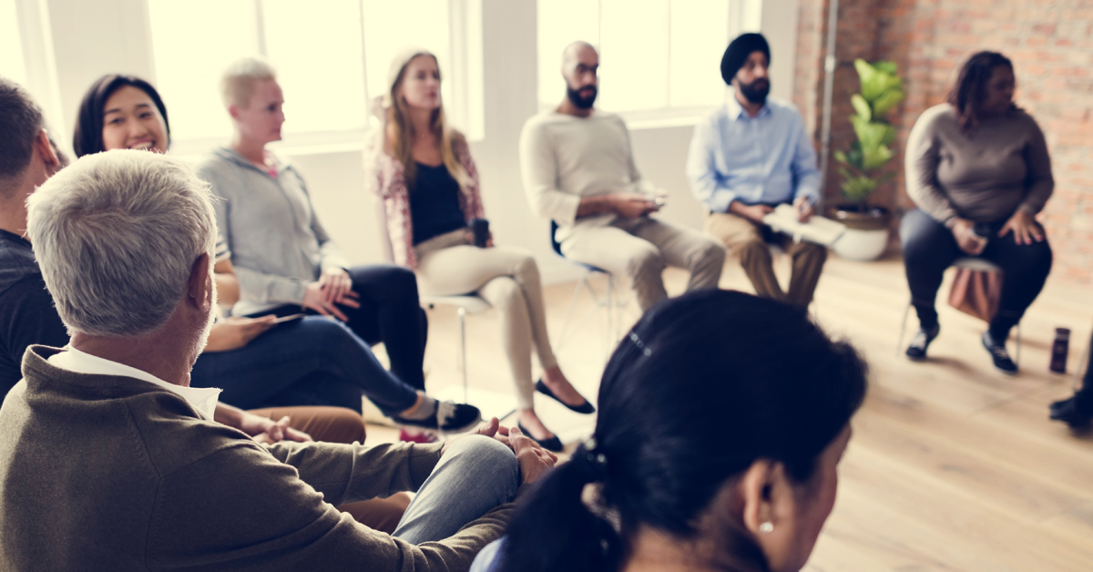 Diverse group of individuals meet to discuss ideas