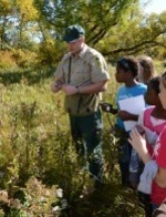 naturalist leading hike