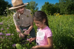 naturalist and child in prairie garden