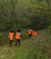 group hiking in blaze orange vests
