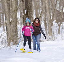 Mother and daughter snowshoe