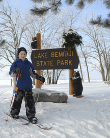 boy at lake bemidji state park sign