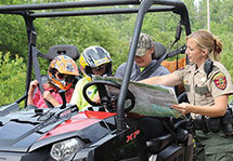 Enforcement Officer helping ATV riders