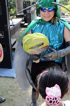 Emerald ash borer volunteer in costume at the Minnesota State Fair