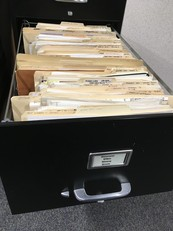 Traditional old file cabinet with paper files